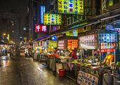 TAIPEI, TAIWAN - JANUARY 12, 2013: Food vendors operate at a night Market on Guangzhou Street. Night
