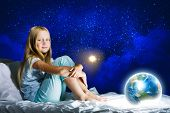 stock photo of sweet dreams  - Girl sitting in bed and dreaming - JPG