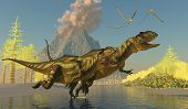 stock photo of behemoth  - Two Yangchuanosaurus dinosaurs splash across a stream as a volcano erupts with smoke and ash - JPG