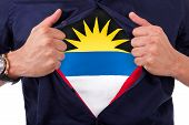 Young Sport Fan Opening His Shirt And Showing The Flag His Country Antigua And Barbuda, Antiguan Fla