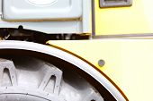 picture of dozer  - Detailed view of heavy vehicle big wheel of the building dozer or other construction machinery - JPG