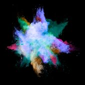 stock photo of ashes  - Freeze motion of colored dust explosion isolated on black background - JPG