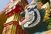 image of gatekeeper  - Temple entrance in the capital of Laos - JPG