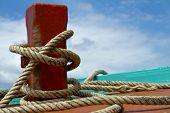 picture of bollard  - Ship hemp cable bound over a mooring bollard - JPG