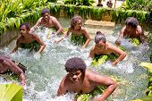 Melanesian women perform a water dance in Luganville, Vanuatu