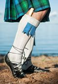 stock photo of kilt  - Legs of man in scottish blue and green kilt - JPG