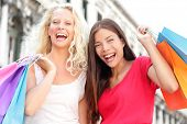 Friends shopping women excited and happy screaming joyful in Venice, Italy. Two girlfriends holding
