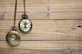 Vintage Pocket Watches On Wooden Background