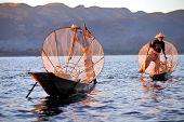 INLE LAKE, MYANMAR - DECEMBER 12, 2013: Fishermen at Inle Lake, Shan State, Myanmar Intha people pos