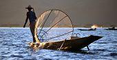 INLE LAKE, MYANMAR  DECEMBER 12, 2013: Fishermen at Inle Lake, Shan State, Myanmar Intha people poss