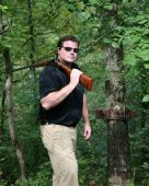 Man Carrying A Shotgun