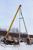 Construction Of Power Lines Using A Mobile Crane