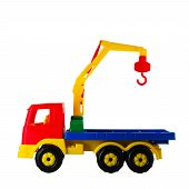Hoisting crane toy on a white isolated