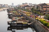 Flower boats at flowers market on Binh Dong wharf