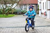 Happy Boy Of Three Years Riding On Bicycle In Autumn Or Winter, Outdoors