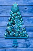 Blue And Turquoise Christmas Tree Of Decoration Balls On Wood.