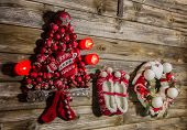 Vintage Christmas Decoration: Red, White Things On Wooden Background.