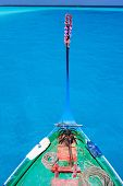 foto of dhoni  - Close up of a traditional maldivian boat dhoni in a tropical ocean - JPG