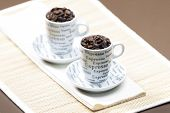coffee cups full of coffee beans