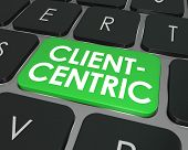 Client Centric words on green computer keyboard button for internet or online business focused on needs of customers