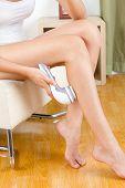 Woman Polishing Her Leg With Polish Machine