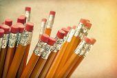 Lead pencils against a vintage paper background