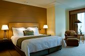 image of glass-wool  - Classic bedroom of a 5 star luxury suite hotel with attached living room - JPG