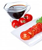 Balsamic vinegar,  tomato and basil isolated on white