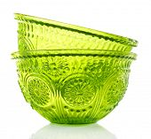 Green glass bowl isolated on white