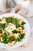 Green salad with apples, walnuts and cheese on light background