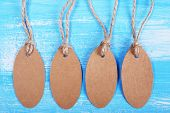 empty tags on blue wooden background