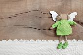 Top View Of Angel With Crochet Strip On Wooden Background For Christmas