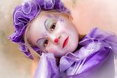 Beautiful little blond girl in clown disguise