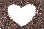 Black peppercorn in shape of heart.