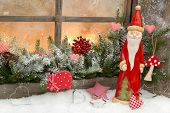 Natural Christmas Decoration With Santa Claus In A Wooden Window