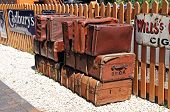 Old leather suitcases on railway platform.