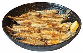 Fried Fish Capelin On Frypan Isolated On White