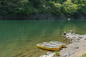 KYOTO, JAPAN - APRIL 26th  : Three canoes docked at the shore of Hozu(Katsuragawa)  River in Arashiy