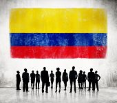 Silhouettes of Business People and a Flag of Colombia