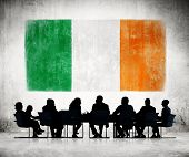 Business People in a Meeting with Irish Flag