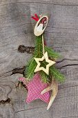 Red And Green Christmas Decoration With Antler And Stars On Wooden Background