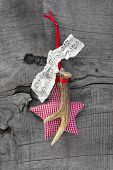 Top View Of  Christmas Decoration With Checked Heart, Antler On Wooden Background
