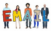 Multiethnic Group of People Holding Letter with Email Concept
