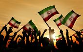 Silhouettes of People Holding Flag of Iran