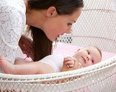 Attractive Woman With Baby In Cot