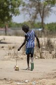 BOR, SOUTH SUDAN-FEBRUARY 25 2013: Unidentified boy plays with home made toy in the village of Bor,