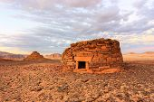 image of empty tomb  - Ancient tombs in the desert glow orange in the late evening sun - JPG