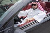 Arabic young businessman driving car