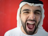 Arabic young businessman in joy