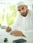 Arabic young businessman posing in office